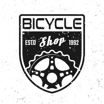 Bicycle shop vector shield emblem, badge, label or logo in vintage style isolated on background with removable grunge textures