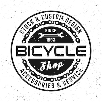 Bicycle vector round emblem, badge, label or logo in vintage style isolated on background with removable grunge textures