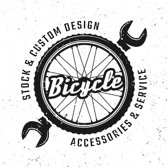 Bicycle wheel and wrench vector round emblem, badge, label or logo in vintage style isolated on background with removable grunge textures