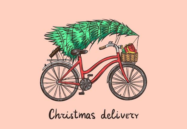ピンクで隔離のクリスマスツリーと自転車