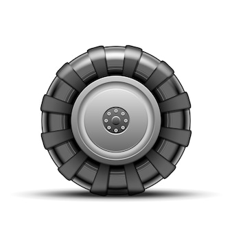 Grande ruota nera del trattore isolata