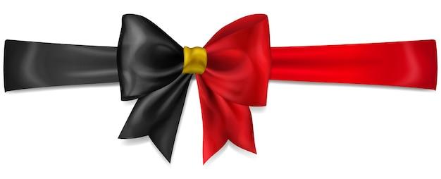 Большой бант из ленты в цветах флага бельгии с тенью на белом фоне
