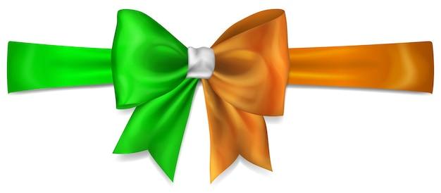 흰색 배경에 그림자가 있는 아일랜드 국기 색상의 리본으로 만든 큰 활