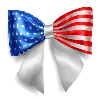 白い背景の上の影と米国旗の色のリボンで作られた大きな弓