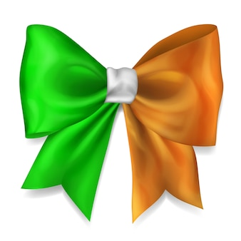 Big bow made of ribbon in ireland flag colors with shadow on white background