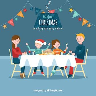 クリスマスディナーを持つ大家族