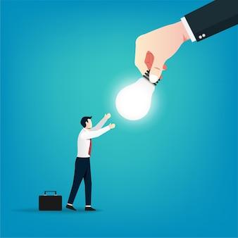 큰 손은 사업 개념에 아이디어 전구를 제공합니다.