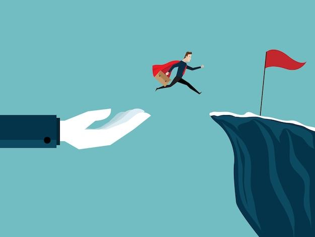 大きな手の助けを借りて実業家は崖で赤旗にジャンプする