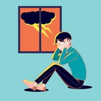 雷雨の恐怖に苦しんでいる大きな孤立した若い男。