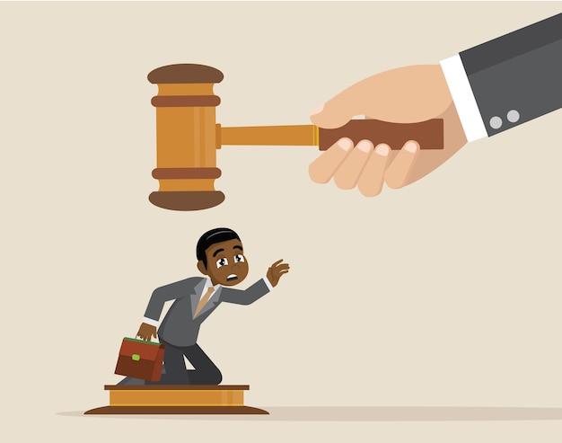Big judge banging gavel on small businessman.
