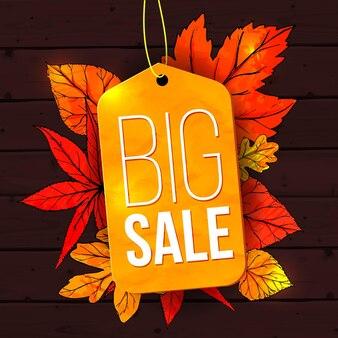 Большая распродажа баннер с осенними листьями и желтой биркой на деревянном фоне осенняя распродажа