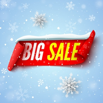 Big sale banner with red ribbon, snow cap and snowflakes.