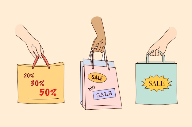 Big sale, shopping, discount in shops concept. people hands holding colorful shopping or gift bags with sale percents and discounts