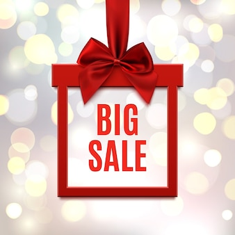 Big sale, square banner in form of gift with red ribbon and bow, on blurry bokeh background. brochure, greeting card or banner template.