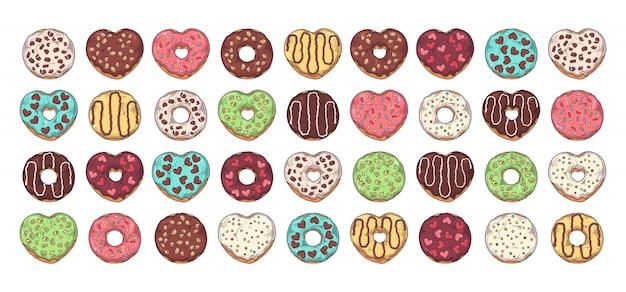 유약 도넛의 큰 세트는 토핑, 초콜릿, 견과류로 장식되어 있습니다.