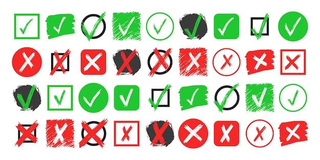 白い背景に分離された手描きのチェックとクロスサイン要素の大きなセット。グランジ落書き緑のチェックマークokと赤のxを異なるアイコンで表示します。ベクトルイラスト