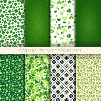 クローバーの葉と聖パトリックの日のアイルランドのシームレスな背景のパターンの大きなセット