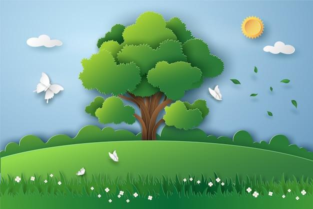 大きな木と環境エネルギーと環境の概念と緑の自然の風景の中の蝶。紙のベクトルイラストアートデザインカットスタイル。