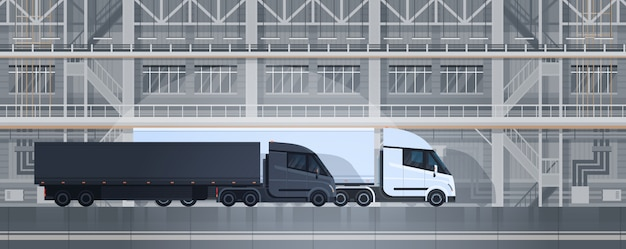 Big truck trailers in industrial warehouse container delivery shipping cargo concept