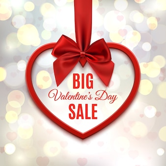 Big valentines day sale, poster template. red heart with red ribbon and bow, on abstract background with hearts and bokeh circles.