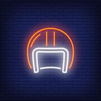 Biker helmet on brick background. neon style illustration.