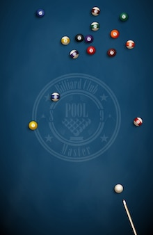 Billiard balls and cue on blue cloth.