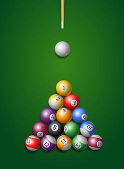 Billiard balls, cue in a pool table