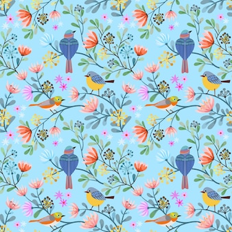 Bird on branch with flowers seamless pattern.