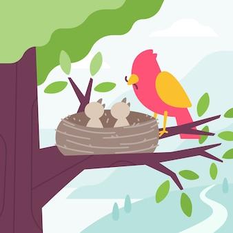 Bird feeding chicks with worm in the tree nest