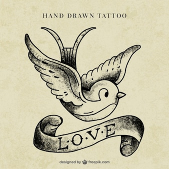 Bird with a ribbon tattoo