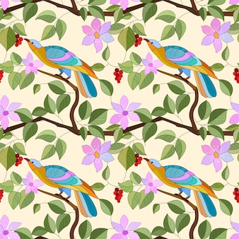 Birds on branch with flowers seamless pattern.