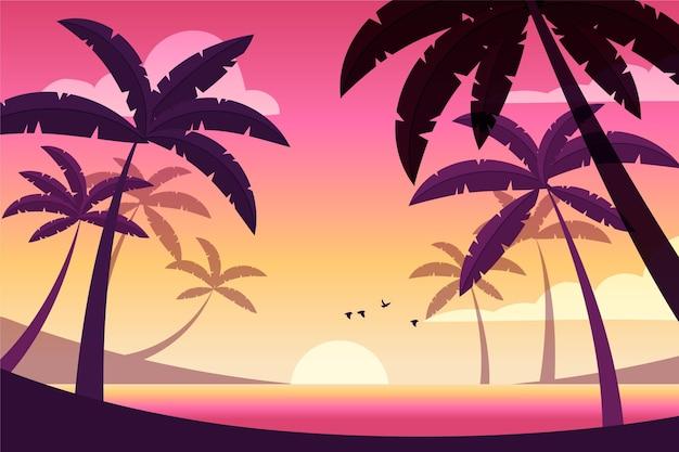 日没の背景に飛んでいる鳥