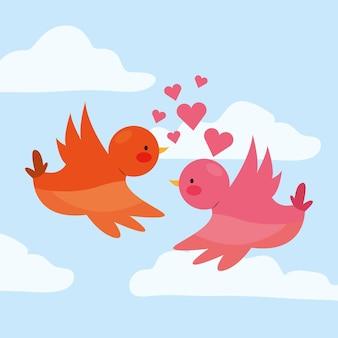 하트와 구름 사이를 비행하는 사랑에 새. 발렌타인 데이.