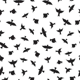 鳥のシームレスなパターン。鳥の黒いシルエット。鳥の簡単な概要。白色の背景。ベクトルイラスト