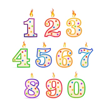 The birthday candles in the different numbers form with fire on white
