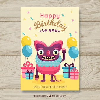 Birthday card with funny monster in flat style
