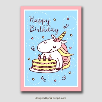 Birthday card with unicorn, cake and confetti