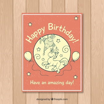 Birthday card with unicorn in modern style