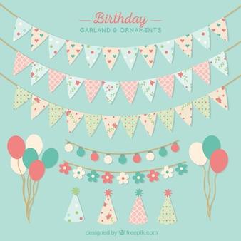 Ghirlande di compleanno e ornamenti in colori pastello