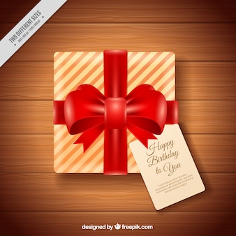 Birthday gift background with red ribbon