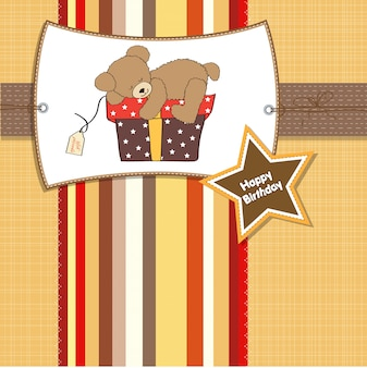 Birthday greeting card with teddy bear and big gift box