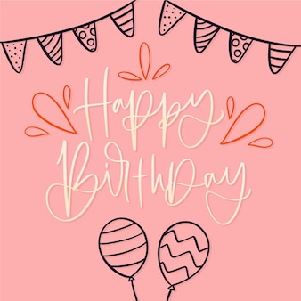 Birthday lettering with ribbons and balloons