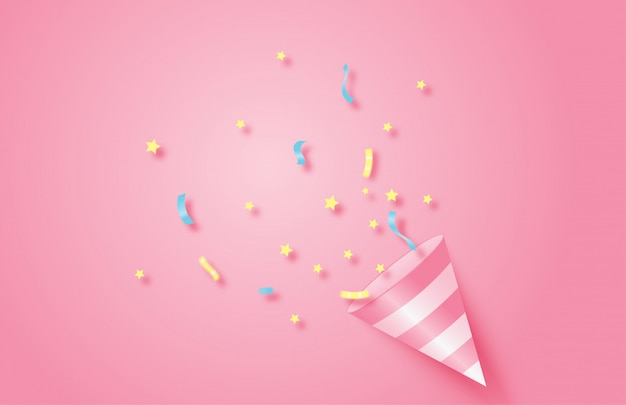 Birthday party background. exploding pink popper cone with confetti.