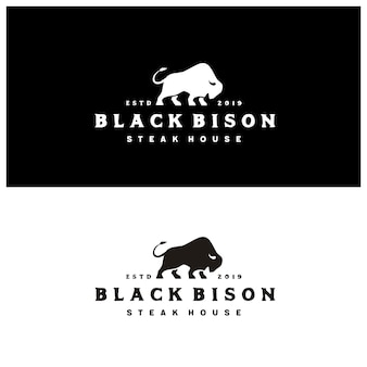 Bison silhouette with vintage typography steak house logo