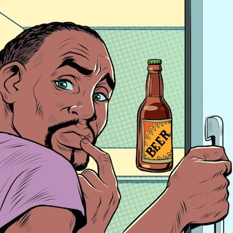 A black african american man near the refrigerator with beer alcohol addiction