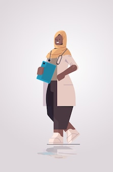 Black african muslim woman doctor in uniform holding checklist medicine healthcare concept full length vertical vector illustration