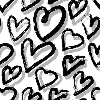 黒と灰色の手描きのハートの白い背景のシームレスなパターン。黒のフリーハンドインク。 2月14日。ベクトルイラスト。