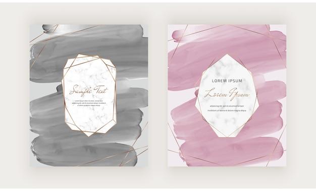 幾何学的な大理石のフレームを持つ黒とピンクのブラシストローク水彩画カード。