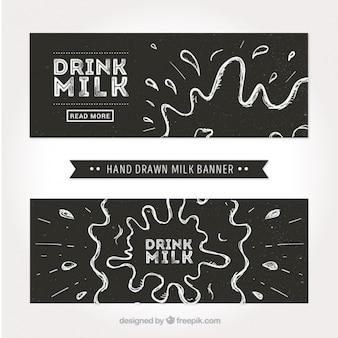 牛乳の飛沫と黒と白のバナー