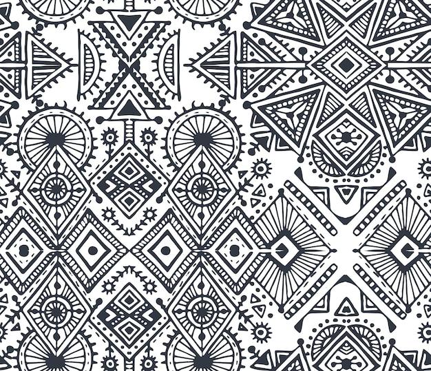 手描きの要素を持つ黒と白の民族部族のシームレスなパターン。アステカの幾何学模様。流行に敏感な無限の背景。